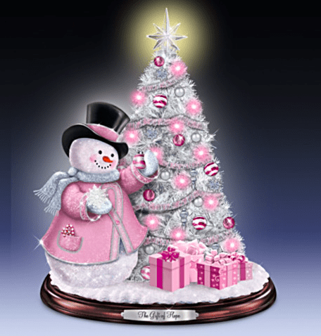 Gorgeous pink tabletop tree features a cheerful snowman all decked out in pink.  Supports Breast Cancer Awareness - beautiful decor for a fabulous cause!
