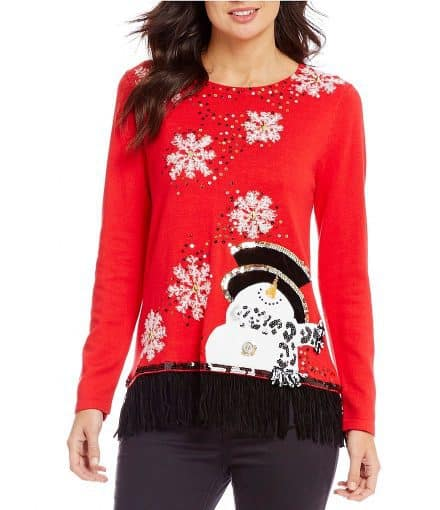 Bright and cheerful snowman Christmas sweater features sequined snowflakes for extra sparkle.