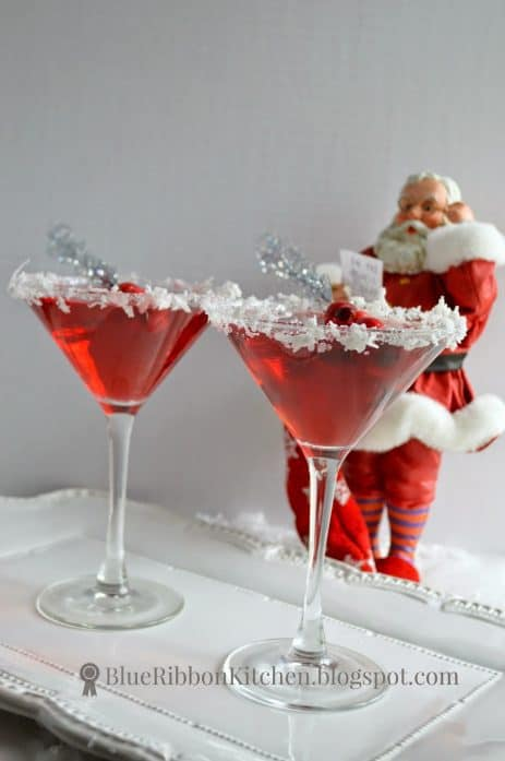 Brightly colored Santa Clausmopolitan is the perfect drink to make your signature holiday cocktail.