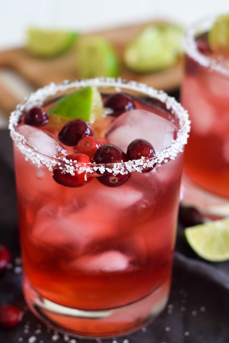 These festive easy cranberry margaritas are a great way to get your Ugly Christmas Sweater party started!