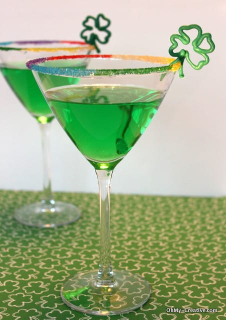 St Patricks Day Green Apple Martini - How fun is this cute green apple martini? The rainbow rimmed glass and chocolate shamrock add such a festive touch!