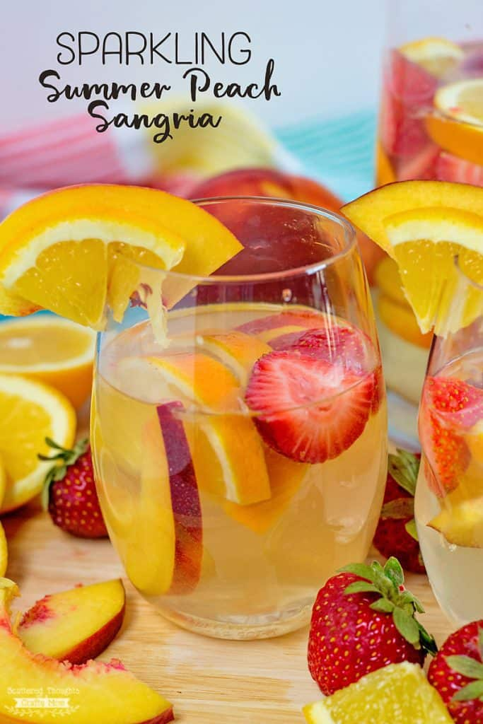 Looking for an easy summer sangria recipe?  Click to get this delicious sparkling peach sangria recipe...the perfect sangria for hot summer days!