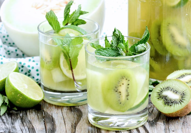 Honeydew and kiwi low calorie sangria recipe - Indulge in a decadent summer sangria that won't break your diet...Delightful skinny sangria is under 125 calories!  Click for recipe.