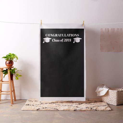 Personalized graduation photo booth backdrop - if you're using a cloth backdrop for your grad party photo book, use clothespins to hang the background from twine. Click for details and more grad party photo booth ideas.