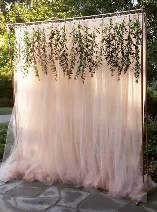 Gorgeous photo booth backdrop for an outdoor party! Click for details.