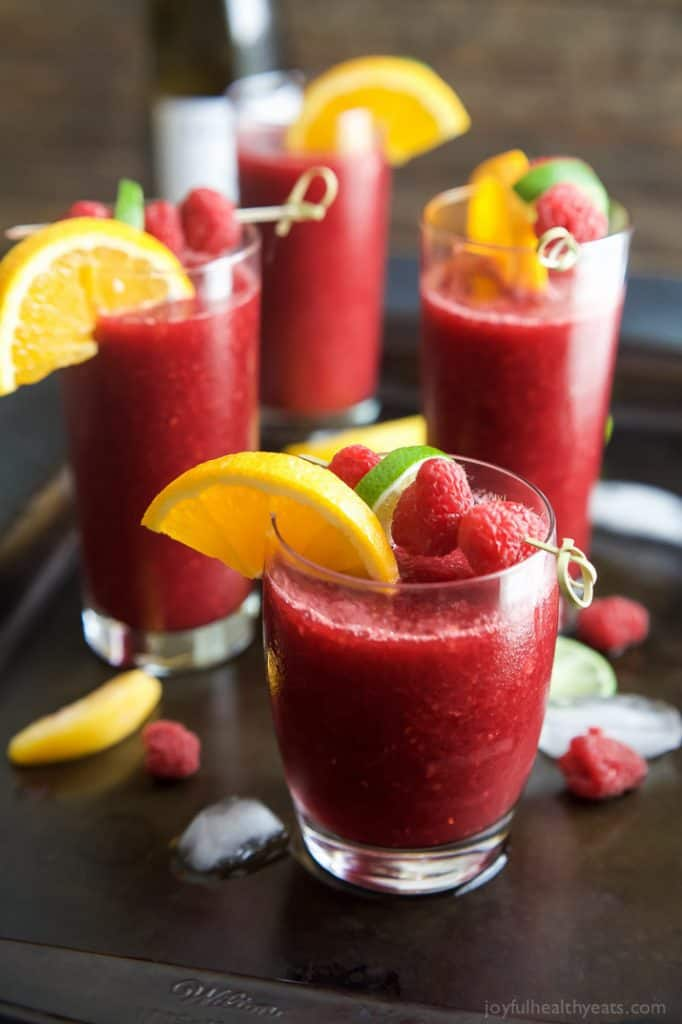 Skinny Frozen Raspberry Peach Sangria - Looking for a fabulous summer sangria recipe that's lower in calories?  Click to get this incredible frozen sangria recipe...only 131 calories!