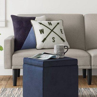 Dorm Ottoman with Storage - Get extra storage and a comfy place to sit with this affordable (under $20) ottoman.  Perfect for your tiny college dorm room!  #FINDinista #dormroom #dormroomideas