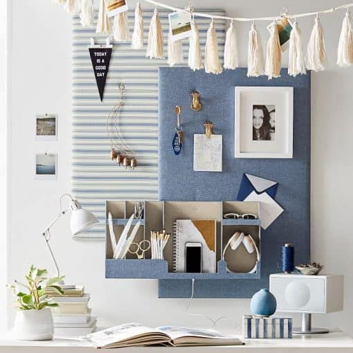 Dorm room organizing ideas - Add organizers to your dorm room walls. Be sure to look for organizers that can be hung without nails, such as these cute (and functional) No Nail organizers from Pottery Barn Teen.