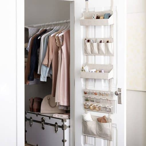 Dorm Room organization tips - take advantage of your closet door with this handy over the door storage system.