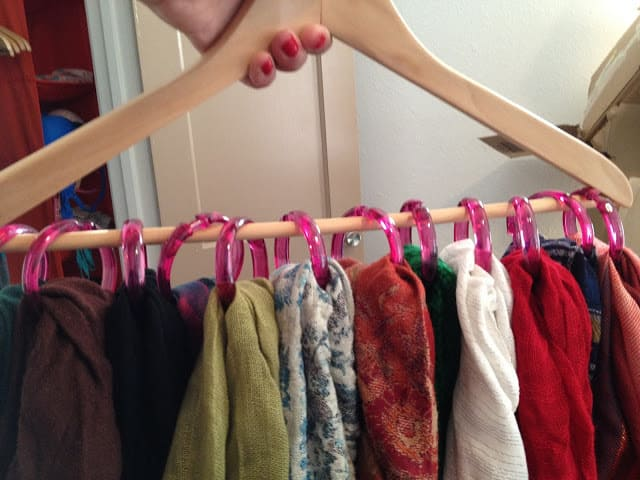 Dorm Room Organization Hacks - Keep your scarf and belts organized and tidy by using shower hooks attached to a hanger. You can even wrap the hanger with adhesive gauze to keep the hooks from sliding around it that bothers you.