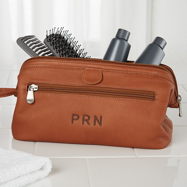Christmas Gifts for Men - upgrade his dopp kit to a handsome personalized leather toiletry bag.