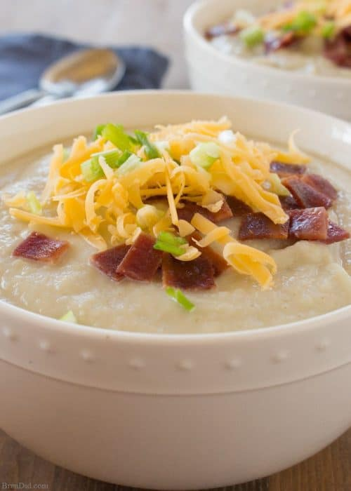 Skinny Potato Soup - Looking for a delicious baked potato soup recipe that's lower in fat in calories?  Check out this scrumptious recipe that replaces some of the potatoes with healthy cauliflower!  #FINDinista.com  #healthysoup