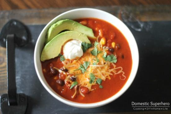 Skinny Enchilada Soup recipe is quick to make with loads of flavor...but not so many calories!  #FINDinista.com #healthysoup