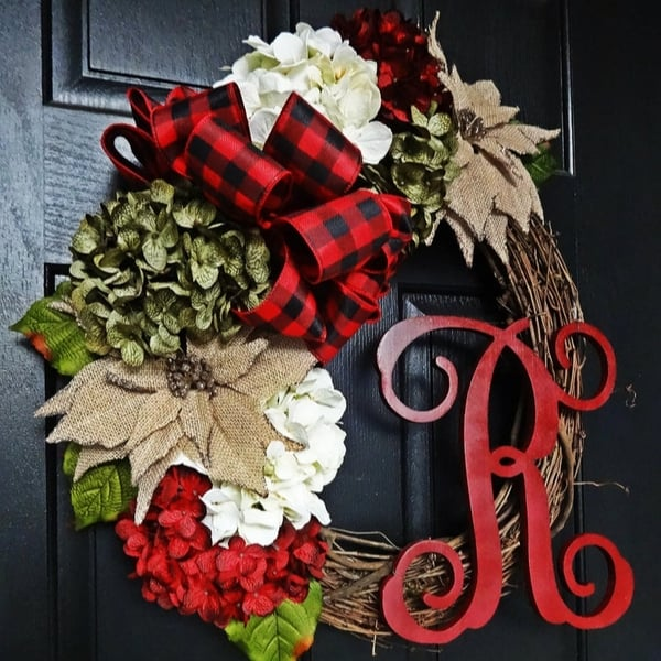 How lovely is this rustic Christmas wreath that features a monogram? It's a thoughtful Christmas gift for an elderly woman...even the woman in a nursing home can hang it on her door to brighten her room throughout the holiday season. #FINDinista #christmaswreath #christmasgifts