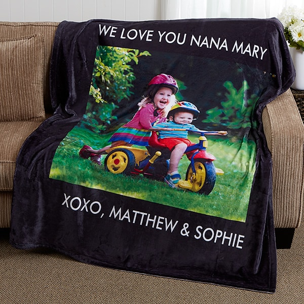 Personalized Photo Blanket for Nana - She'll be warm and cozy when she wraps herself up in a soft blanket that features pictures of her grandkids! Choose from 10 vibrant colors for the blanket, then upload up to 6 photos. Add your own loving message to the top and bottom to create a Mother's Day, Christmas or birthday gift Nana will treasure forever! #FINDinista #nanagifts #personalizedblanket
