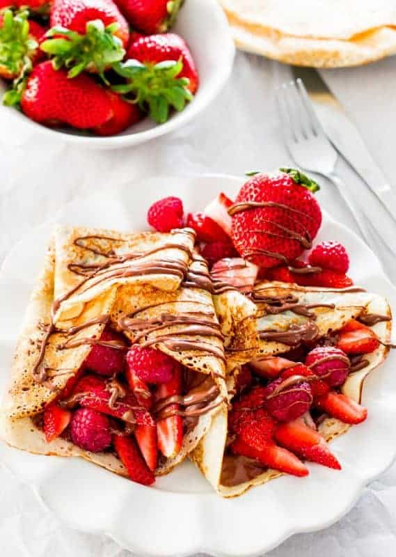 Mother's Day Breakfast idea - Impress Mom with these delicious nutella and strawberry crepes!