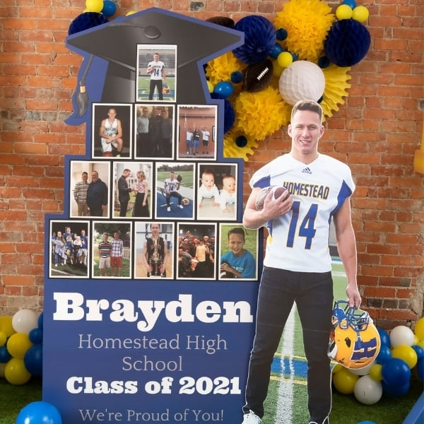 Graduation photo display ideas - oversized (7.5 feet tall!) picture display is sure to the be hit of your party!